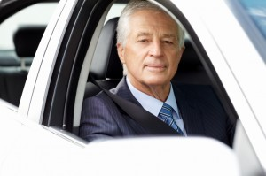 Mature Businessman in a Car
